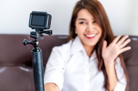 Photo pour Closeup of action camera with professional digital content creator blogger recording video blog presentation clip for upload to website as coach and tutor to making for popular vlog and master class - image libre de droit
