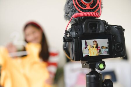 Photo for Professional DSLR digital camera film video live with vlogger blogger interview background. Woman coaching trading and review clothing product. Business presentation training class. People lifestyle - Royalty Free Image