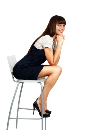 Photo for young beautiful businesswoman sitting on chair and smiling - Royalty Free Image