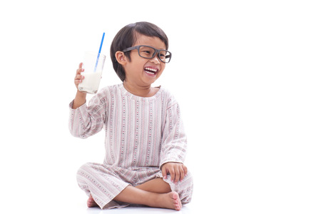 Cute boy drink milk isolated on white