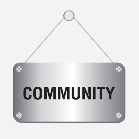silver metallic community sign hanging on the wall