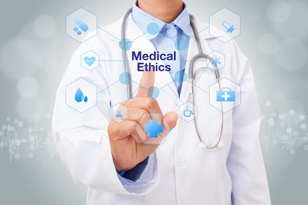 Doctor hand touching medical ethics sign on virtual screen. medical concept