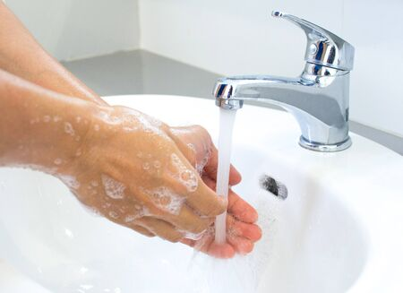 Photo pour Hygienic concepts Wash your hands with soap under the tap with clean water for protection against viruses. - image libre de droit