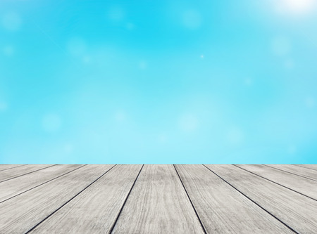 abstract blue light background and perspective wooden plank