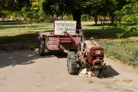 A vehicle of ASI department of indian government for collective garbage from lawn at old fort.