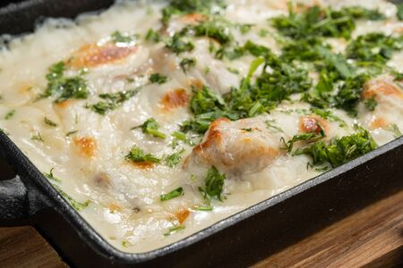 Photo pour Cheese casserole with chicken and herbs. Beautiful baked crust. - image libre de droit