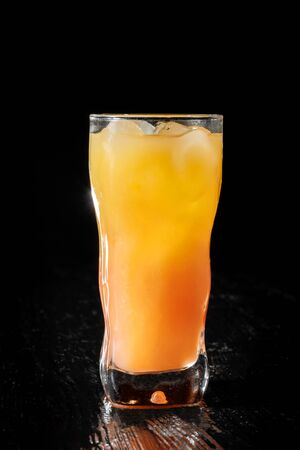 Photo for Paradise is a cocktail that contains gin, apricot brandy and orange juice. - Royalty Free Image