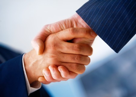Closeup picture of businesspeople shaking hands, making an agreement.の写真素材