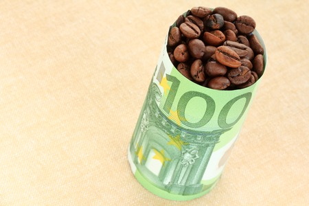 Coffee beans wrapped with 100 Euro Banknote