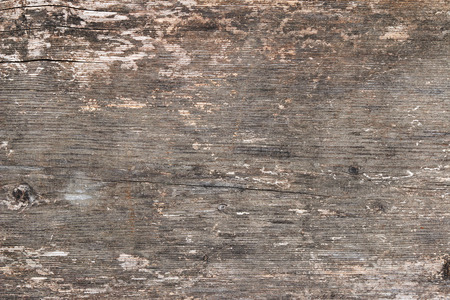 Background texture photo of rustic weathered barn wood with cracks