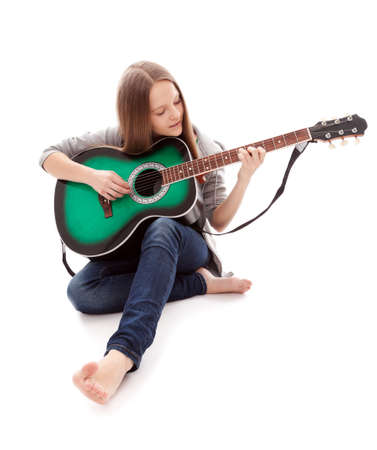 young beauty music girl with guitar on white background