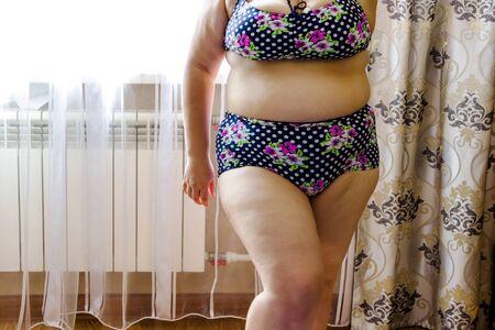 Foto de pictured in the photo young woman posing in a purple swimwear - Imagen libre de derechos