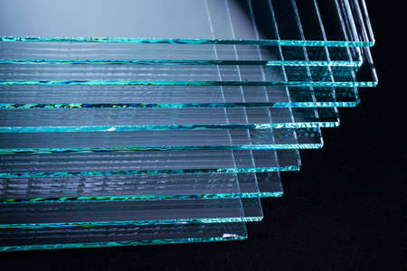Photo pour Sheets of Factory manufacturing tempered clear float glass panels cut to size - image libre de droit