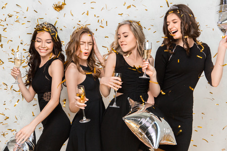 Young women together celebrating hen party isolated on white