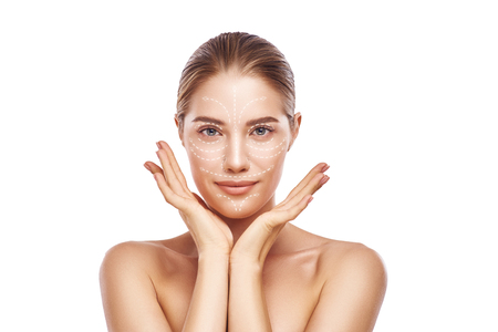Photo pour Face Lifting. Portrait of gorgeous and young woman with fresh clean skin and lifting arrows over her face. Isolated on white background. Cosmetic Medicine. Anti aging treatment. - image libre de droit