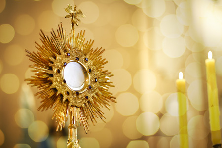 Photo for Ostensory for worship at a Catholic church ceremony - Adoration to the Blessed Sacrament - Catholic Church - Eucharistic Holy Hour - Royalty Free Image
