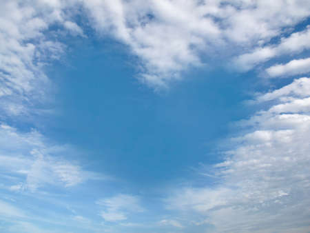 Heart-shaped cloud on clear blue sky during the day. Romantic love concept