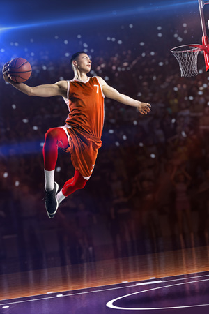 Photo for Basketball player in jump. around Arena with blue light spot - Royalty Free Image