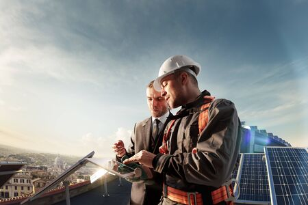 Photo for engineer and businessman planing new ecology project. around solar panel and roof - Royalty Free Image