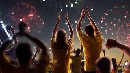 Photo pour Fans celebrate in Stadium Arena night fireworks - image libre de droit