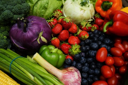 Fresh organic fruits and vegetables on a wooden table