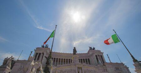 The Altare della Patria located in Rome, Italy. And the Italian national flag