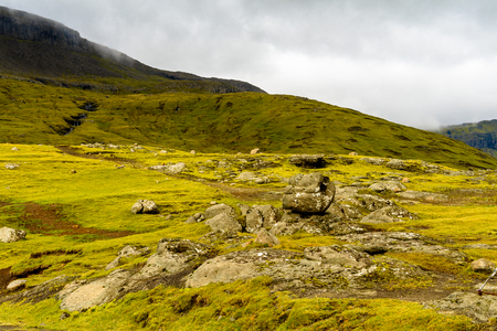 Rocks of Sandoy, one of the biggest of all the Faroe Islands, autonomous region of the Kingdom of Denmark