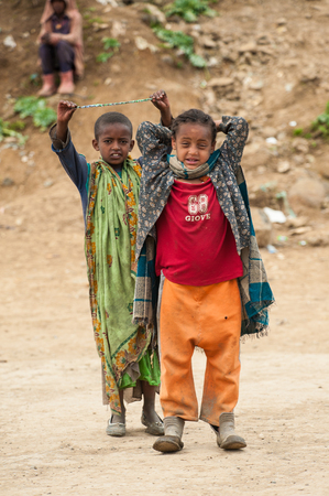 OMO, ETHIOPIA - SEPTEMBER 22, 2011: Unidentified Ethiopian boys pose for the camera. People in Ethiopia suffer of poverty due to the unstable situation