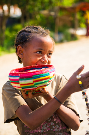 OMO, ETHIOPIA - SEPTEMBER 20, 2011: Unidentified Ethiopian beautiful girl tries to sell traditional beads. People in Ethiopia suffer of poverty due to the unstable situation