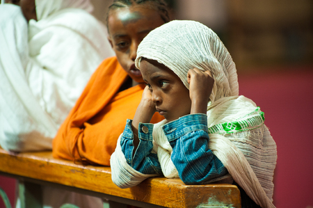 AKSUM, ETHIOPIA - SEPTEMBER 24, 2011: Unidentified Ethiopian little girl thinks. People in Ethiopia suffer of poverty due to the unstable situation