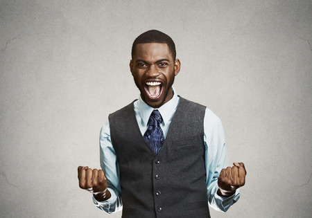 Photo pour Closeup portrait happy successful student, business man winning, fists pumped celebrating success isolated grey wall background. Positive human emotion, facial expression. Life perception, achievement - image libre de droit