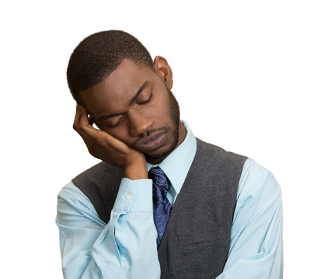 Closeup Portrait Sleepy young Business Man, funny guy placing head on hand, unhappy, Eyes Closed, isolated grey wall background. Negative human emotions, facial expressions, feelings, body language