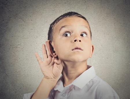 Foto für Curious man, boy, listens. Closeup portrait child hearing something, parents talk, hand to ear gesture isolated grey wall background. Human face expression, emotion, body language, life perception - Lizenzfreies Bild