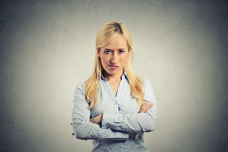 portrait angry blonde woman on grey background