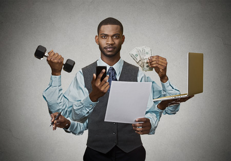 Foto de Multitasking business man isolated on grey wall background. Busy life of company manager corporate executive. Many errands concept - Imagen libre de derechos
