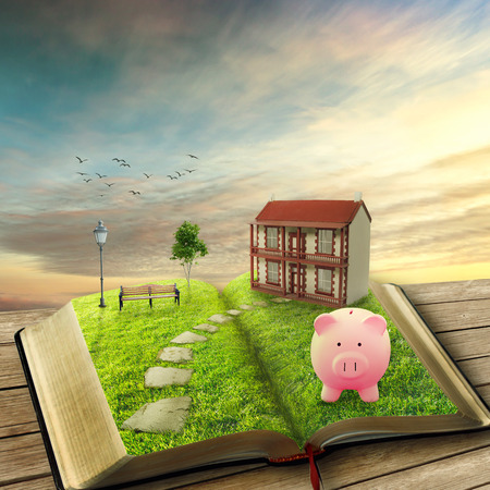 Home savings financial concept. Piggy bank and opened magic book covered with green grass and stoned path way. Fantasy world imaginary view. Original screensaver. Loan market housing industry mortgage