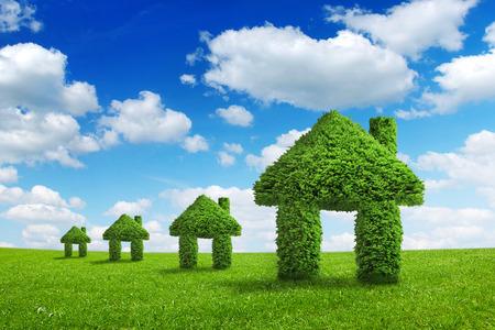 Foto de Environment ecology nature home integration concept. Green houses walking on a summer meadow under the blue sky - Imagen libre de derechos