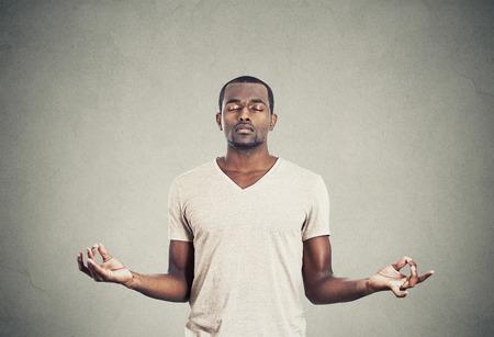 Photo for Young man meditating - Royalty Free Image