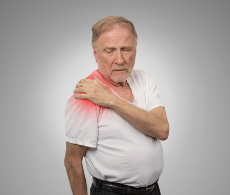 senior man with pain in his shoulder