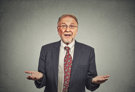 Photo pour Closeup portrait clueless senior mature man, arms out asking why what\'s the problem who cares so what, I don\'t know. Isolated grey . Human emotion facial expression feeling body language - image libre de droit