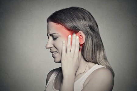 Foto für Closeup up side profile sick female having ear pain touching her painful head temple isolated on gray wall background - Lizenzfreies Bild