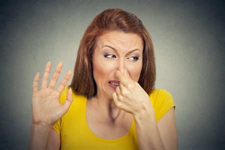Photo pour Closeup portrait young woman disgusted by smell looks displeased - image libre de droit