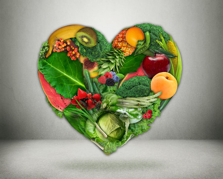 Healthy diet choice and heart health concept. Green vegetables and fruits shaped as heart  Heart disease prevention and food. Medical health care and nutrition dieting