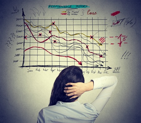 Woman analyst solving bad economy problem. Stressful business life concept