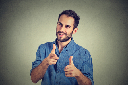 Foto für Portrait handsome young smiling man giving thumbs up pointing fingers at camera, picking you as friend isolated on grey wall background. Positive human emotion facial expression sign body language - Lizenzfreies Bild