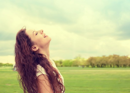 Photo for Side profile woman smiling looking up to blue sky celebrating enjoying freedom. Positive human emotion face expression feeling life perception success, peace of mind concept. Free happy girl - Royalty Free Image