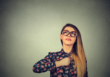 Photo for Superhero girl. Confident young woman in glasses isolated on gray wall background. Human emotions face expression body language perception attitude - Royalty Free Image