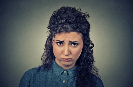 Closeup portrait of angry young woman, upset about to have nervous breakdown isolated on gray wall background. Negative human emotions facial expression feelings attitude
