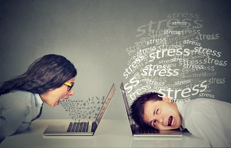Photo pour Side profile angry woman screaming at laptop sitting next to a stressed man. Negative emotion face expression reaction - image libre de droit