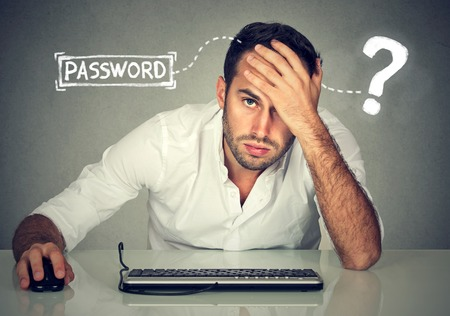 Photo pour Desperate young man trying to log into his computer forgot password - image libre de droit
